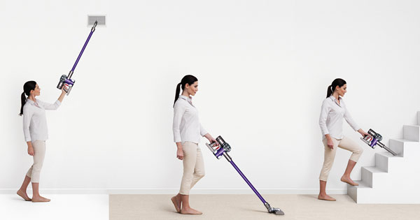 Woman with handheld Dyson vacuum cleaner