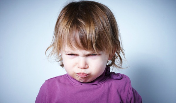 young girl with grumpy face