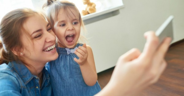 woman and little girl taking a selfie
