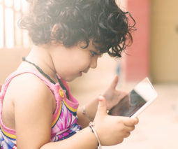 Toddler girl playing with ipad - feature