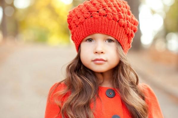 girl wearing orange coat and orange knitted beanie