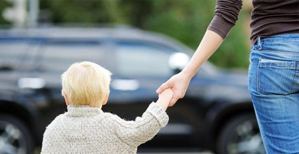child and mum crossing road
