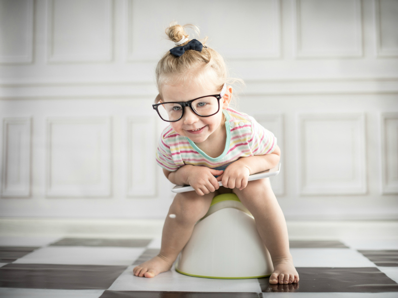 toddler sitting on the potty