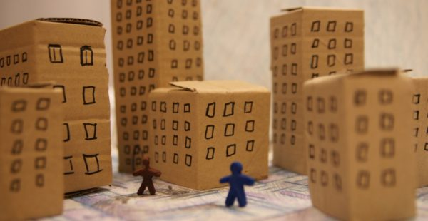 Cardboard city with toy figures
