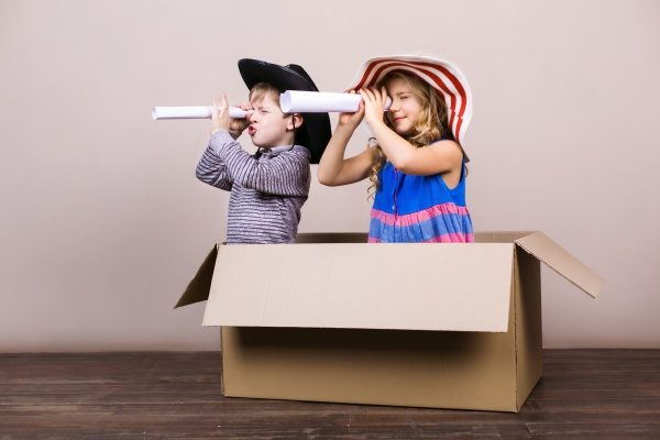 kids playing in cardboard box
