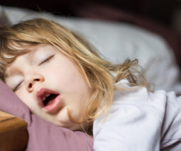 Toddler girl asleep with mouth open - feature