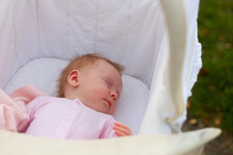 Baby asleep in bassinet