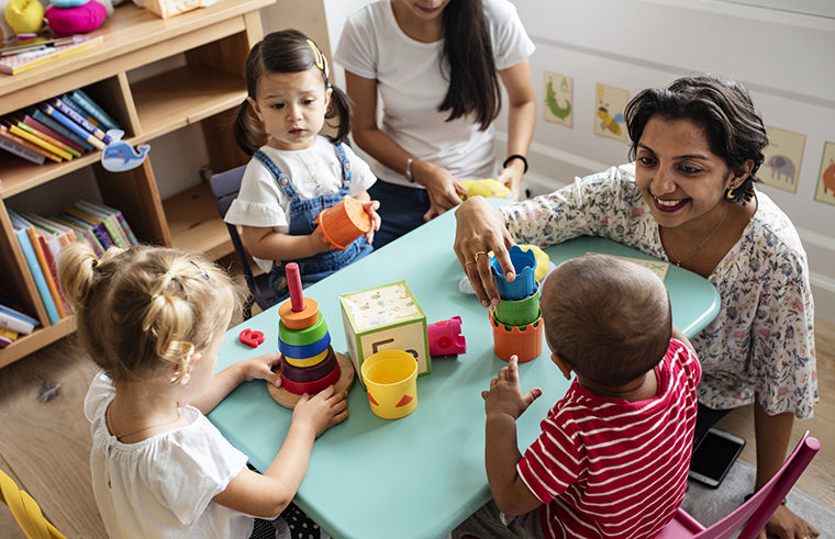 Daycare early childhood educators and kids - feature