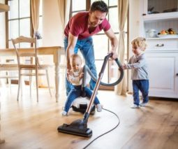 Dad cleaning baby feature