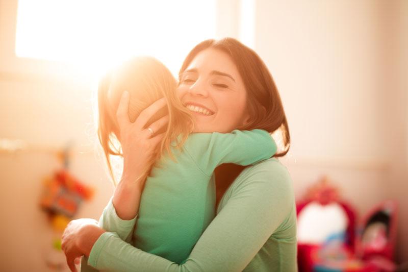Mum hugging daughter