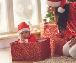 Baby sitting in Christmas gift box - feature