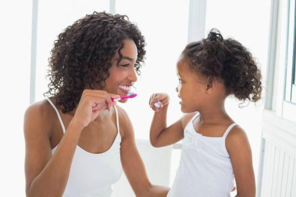 mum daughter brushing teeth