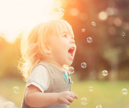 Toddler chasing bubbles - feature