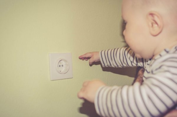 child near electrical socket