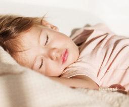 Young preschool girl asleep - feature