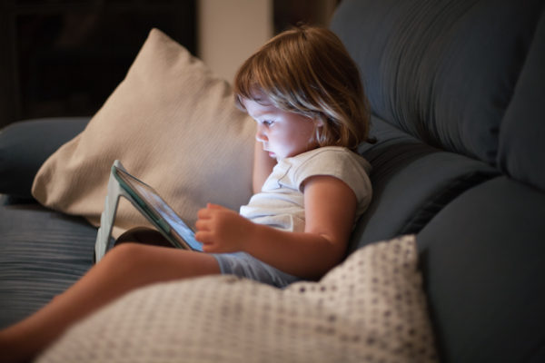 toddler watching video on iPad