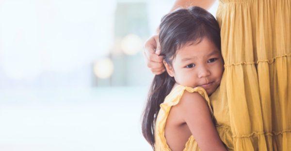 Little girl hugging mum