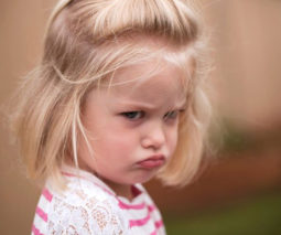 Cranky or angry toddler pouting- feature