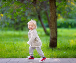 Toddler running in the park - feature