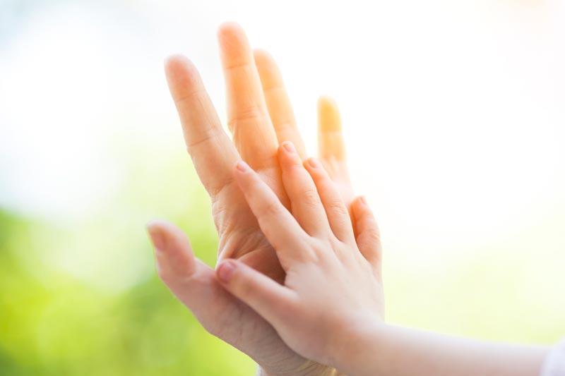 Grandparent and child hands