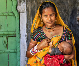 Young indian mother breastfeeding baby - feature