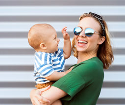 Mother holding baby laughing -feature