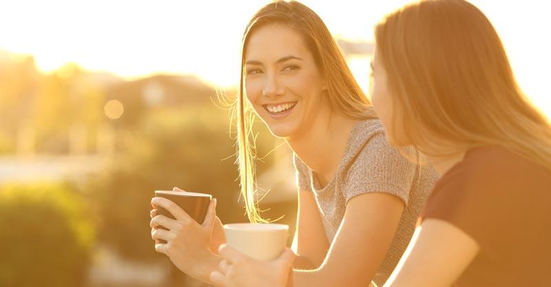 Mum friends drinking coffee outside