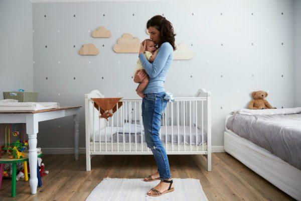 mum comforting baby nursery