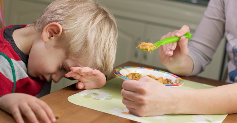 Toddler boy head down not eating food fussy eater
