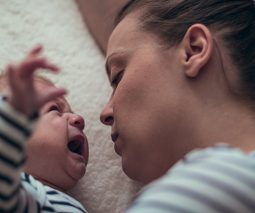 Baby crying with mother