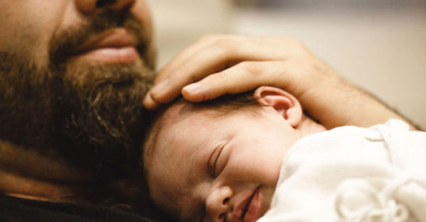 Dad with beard and newborn