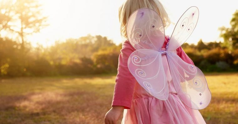 Toddler girl dressed up with fairy wings