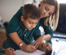 Overbearing mother taking over school child's homework