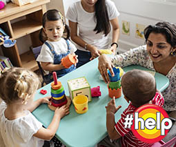 children and childcare with teachers in classroom