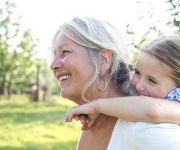 Grandma carrying granddaughter