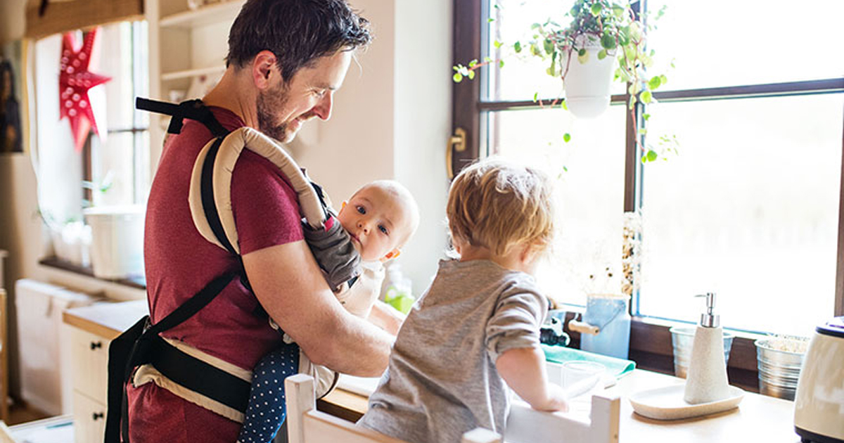 Dad with toddler and baby in carrier