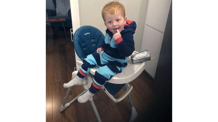 Lucy Kippist's son sitting on top of his highchair tray