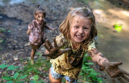 playing in mud - wide