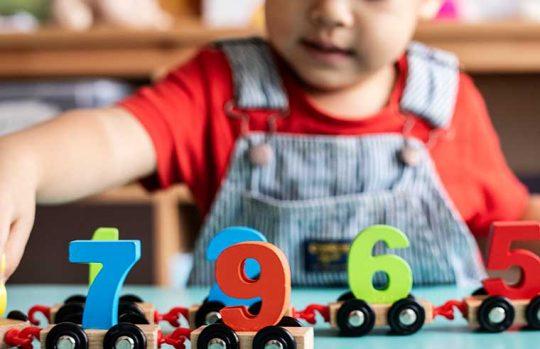 boy playing at preschool
