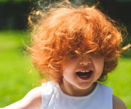Toddler with mop of red hair
