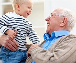 Grandfather holding grandchild