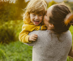 Happy child with mum playing outdoors