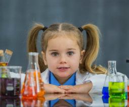 Preschool aged girl dressed as a scientist
