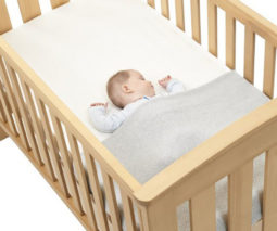 baby sleeping safely in cot