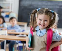 Young girl in school classroom