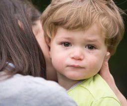 mum comforting toddler