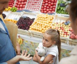 little girl having a tantrum in supermarket