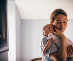 Mother calming baby down