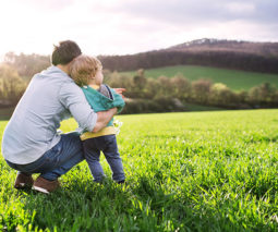 father and toddler enjoying nature in the countryside