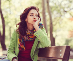 Thoughtful woman sitting in the park